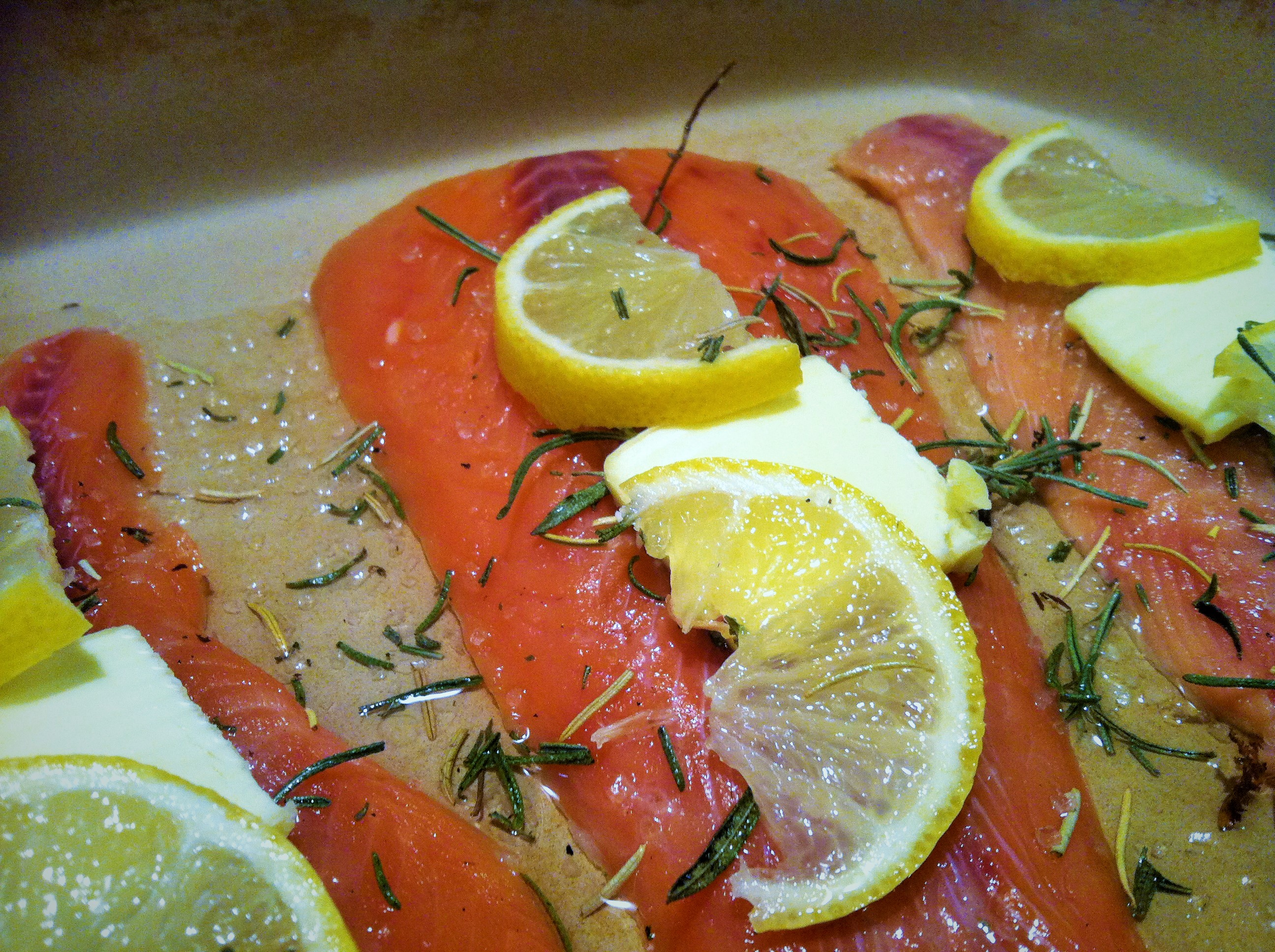 Prepped salmon with butter, lemons and rosemary salt